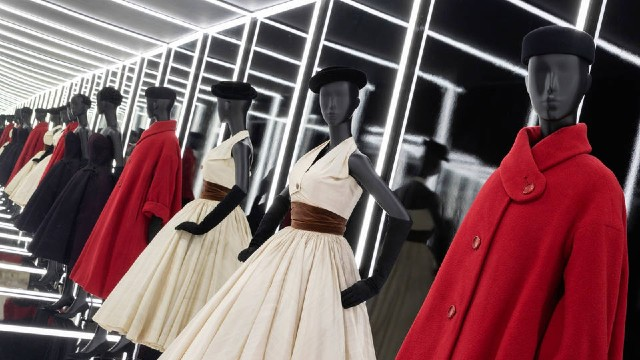 Mannequins are wearing beautiful dresses by Christian Dior as part of an exhibition as the Victoria and Albert Museum in London.
