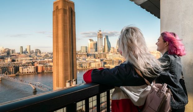Two young women are looking at the horizon from Tate Modern Switch House.